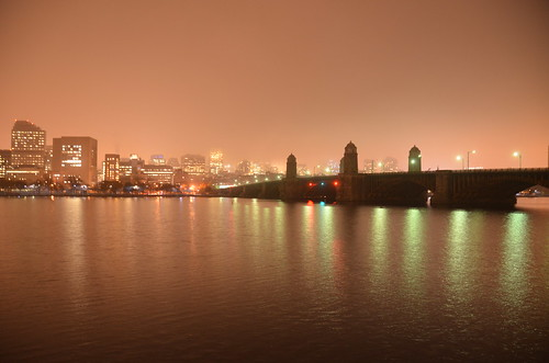 Charles River view of Mass General Hospital and the Longfellow Bridge during a misty evening