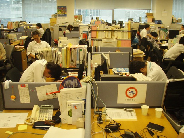 Overworked Workers sleep in their office