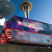 Seattle Monorail In Motion With Space Needle by Surrealize