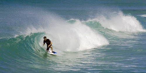 Surfing at Brunswick Heads, NSW, Australia by dirk huijssoon