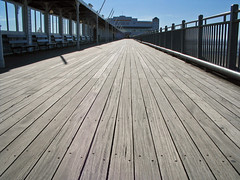floor(0.0), outdoor structure(0.0), roof(0.0), deck(0.0), wood(1.0), boardwalk(1.0), line(1.0), walkway(1.0), flooring(1.0),