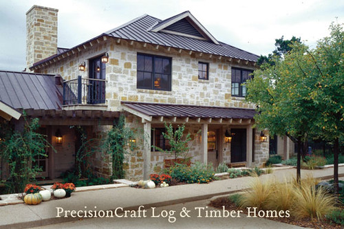 Custom design of a timber frame and log home hybrid for Log and stone home plans