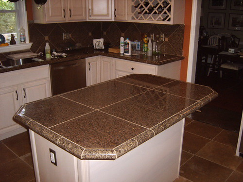 Kitchen remodel with Granite tile countertops and travertine floor ...