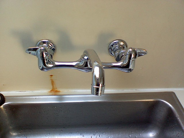 Fixed faucet. Brand spankin new. Just need to bleach rust stains.