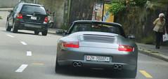 porsche carrera gt(0.0), porsche 959(0.0), automobile(1.0), automotive exterior(1.0), vehicle(1.0), automotive design(1.0), porsche 911(1.0), bumper(1.0), land vehicle(1.0), luxury vehicle(1.0), convertible(1.0), supercar(1.0), sports car(1.0),