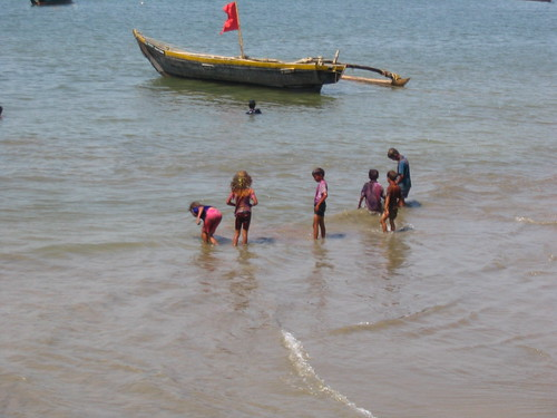 Kids washing off their Holi colors in Malvan sea