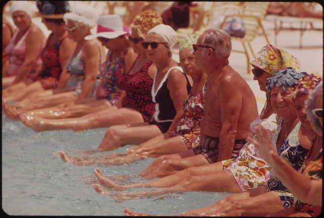 Residents of the Century Village Retirement Community Gather Around Pool for Daily Exercise Session.