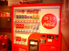 fast food(0.0), machine(1.0), soft drink(1.0), red(1.0), carbonated soft drinks(1.0), drink(1.0), cola(1.0), coca-cola(1.0), vending machine(1.0), brand(1.0),