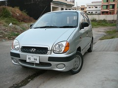 minivan(0.0), automobile(1.0), automotive exterior(1.0), hyundai(1.0), vehicle(1.0), subcompact car(1.0), city car(1.0), land vehicle(1.0),