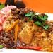Peruvian food: Tacu tacu relleno de conchas negras