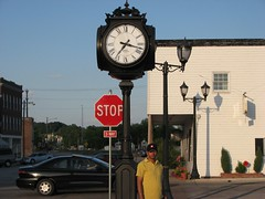 signaling device(0.0), lane(0.0), clock tower(0.0), traffic light(0.0), signage(1.0), light fixture(1.0), transport(1.0), sign(1.0), road(1.0), street sign(1.0), street light(1.0), traffic sign(1.0), downtown(1.0), street(1.0), lighting(1.0), infrastructure(1.0),