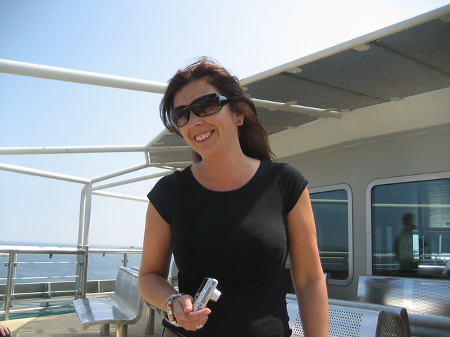Smiling on board a ferry by flickr user zeinah