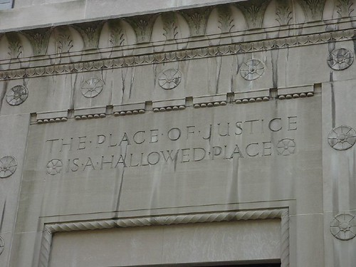 Inscription on DOJ's Building (Photo: rachelvacek, flickr)