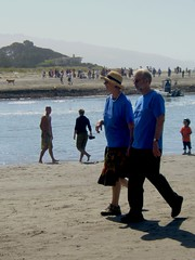 Parents walking on the beach