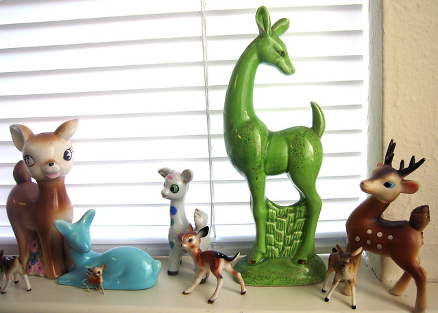 An image of a ceramic deer collection, including one blue and one green deer.