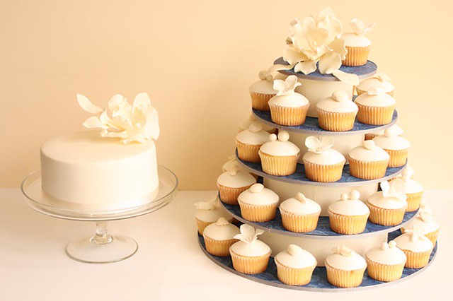 Custom made cupcake tower using paper from wedding stationery