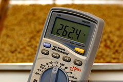 digital multimeter monitoring oven temperature for c…