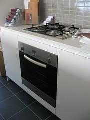 floor(1.0), kitchen appliance(1.0), kitchen(1.0), countertop(1.0), room(1.0), gas stove(1.0), kitchen stove(1.0), flooring(1.0),