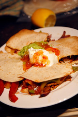 tostada(0.0), bread(0.0), meat(0.0), meal(1.0), breakfast(1.0), flatbread(1.0), tortilla(1.0), produce(1.0), food(1.0), dish(1.0), quesadilla(1.0), cuisine(1.0),