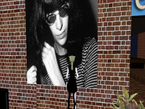 my first avatar in sl in front of a joey ramone pic