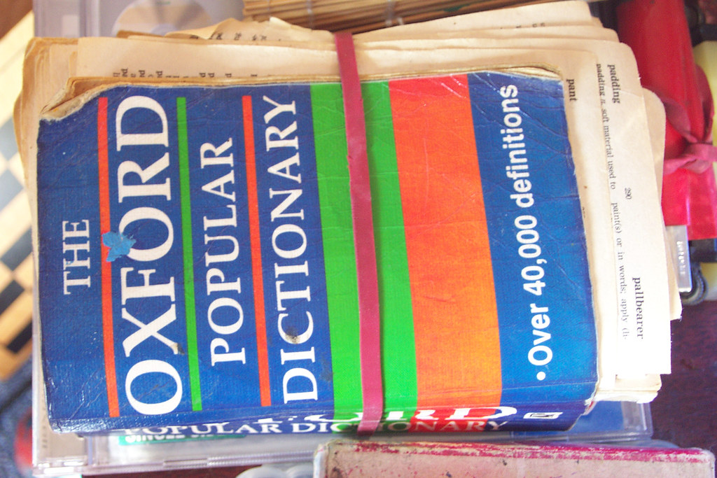 elastic band round a tatty used little Oxford Dictionary I still can't bring myself to throw away
