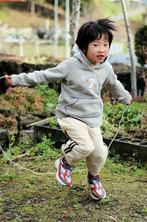 a kid skipping rope