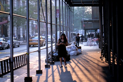 Woman Walking Through the Shadows