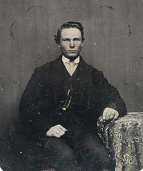 Man sitting by a table, ca 1856-1900.