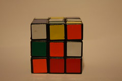 design(0.0), puzzle(1.0), rubik's cube(1.0), red(1.0), mechanical puzzle(1.0), toy(1.0),
