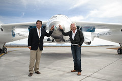 Governor Richardson and Sir Richard Branson with VSS Enterprise after she lands for the first time at Spaceport America. Photo by Jeffrey Vock