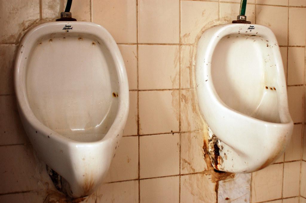 Dirty Toilets in Antigua, Guatemala by Sjoerd van Oosten
