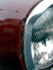 tire(0.0), window(0.0), wheel(0.0), rim(0.0), spoke(0.0), aircraft engine(0.0), automobile(1.0), automotive exterior(1.0), vehicle(1.0), automotive lighting(1.0), light(1.0), glass(1.0), headlamp(1.0),