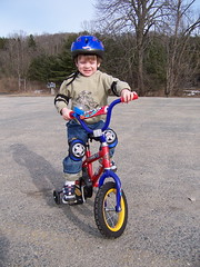 motorcycle(0.0), motorcycling(0.0), tricycle(0.0), bicycle motocross(1.0), vehicle(1.0), training wheels(1.0), bmx bike(1.0), bicycle(1.0),