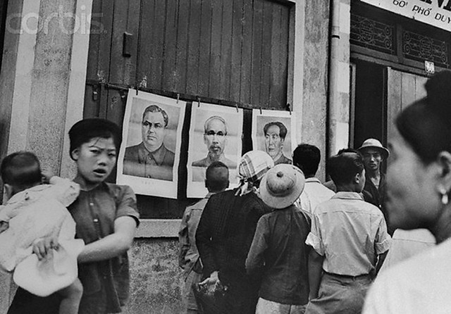 North Vietnamese Looking at Portraits of Communist Leaders
