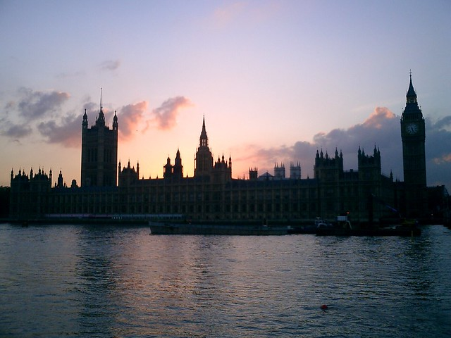 the houses of parliament sunset The gothic spires of the houses of parliament have almost succeeded in piercing through the fog, but they are still reduced to a vague image that does not create a strong reflection in the.