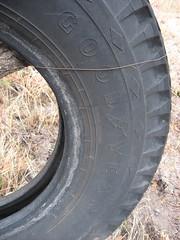 wheel(0.0), rim(0.0), alloy wheel(0.0), bumper(0.0), tire(1.0), automotive tire(1.0), automotive exterior(1.0), synthetic rubber(1.0), tread(1.0),