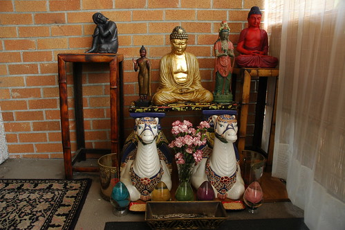 Buddha prostration shrine, 5 Buddhas, on two white camels, front deck, Greenwood, Seattle, Washington, USA by Wonderlane