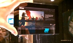 blackberry playbook size next to my tiny hand.egg_b9780