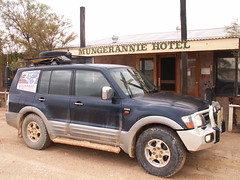 mitsubishi challenger(0.0), off-roading(0.0), automobile(1.0), automotive exterior(1.0), sport utility vehicle(1.0), wheel(1.0), vehicle(1.0), mitsubishi pajero(1.0), compact sport utility vehicle(1.0), rim(1.0), bumper(1.0), land vehicle(1.0), luxury vehicle(1.0),