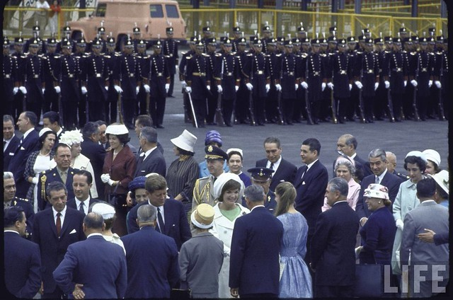 Pres. John F. Kennedy and his wife Jacqueline greeting officials during a state visit to Mexico