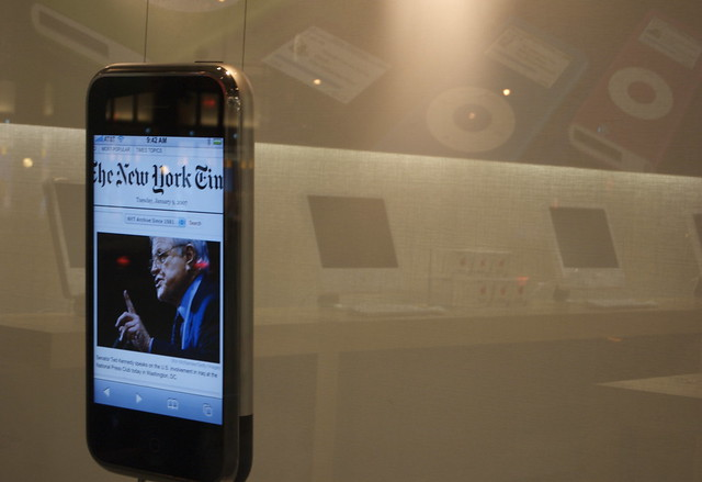 The New York Times app on an iPhone, displayed at an Apple store.