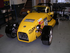 hot rod(0.0), caterham 7 csr(0.0), caterham 7(0.0), sports car(0.0), race car(1.0), automobile(1.0), lotus seven(1.0), yellow(1.0), vehicle(1.0), automotive design(1.0), antique car(1.0), vintage car(1.0), land vehicle(1.0),