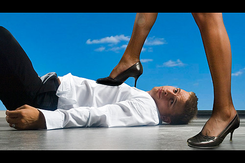 Woman Stepping On Man 3171281991_e1e39fde4c....