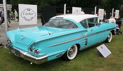 edsel ranger(0.0), edsel corsair(0.0), 1957 chevrolet(0.0), full-size car(0.0), chevrolet bel air(0.0), convertible(0.0), automobile(1.0), automotive exterior(1.0), vehicle(1.0), mercury montclair(1.0), compact car(1.0), antique car(1.0), sedan(1.0), land vehicle(1.0), coupã©(1.0),