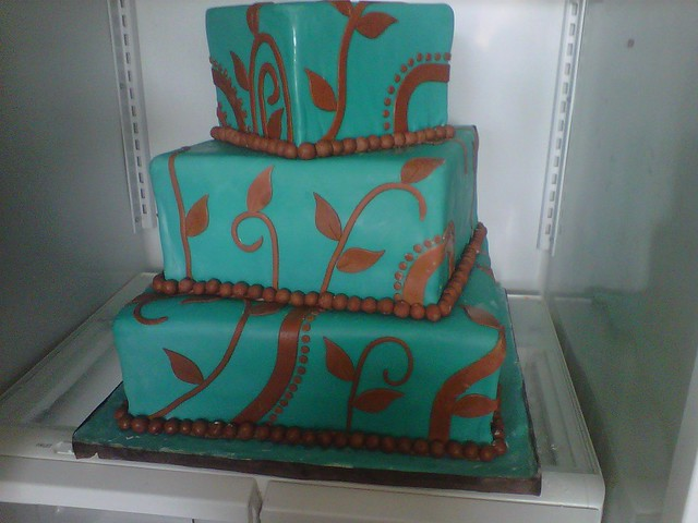 Teal and chocolate brown wedding cake