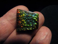 hand(0.0), jewellery(0.0), gemstone(0.0), emerald(0.0), opal(1.0), finger(1.0), yellow(1.0), green(1.0),