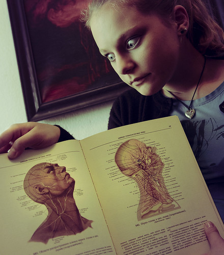 The girl with the anatomy atlas by bolandrotor