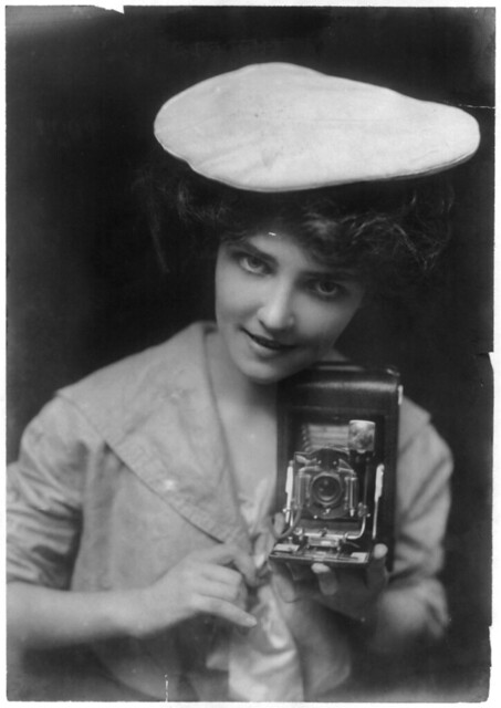 Woman with camera 1909