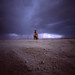 Scott London, before the rain at trash fence by slona