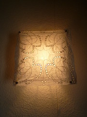 pattern, symmetry, lamp, light fixture, lampshade, sconce, light, design, darkness, lighting,